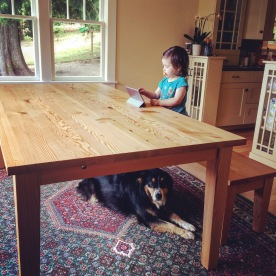 Happy customer at her doug fir dining table