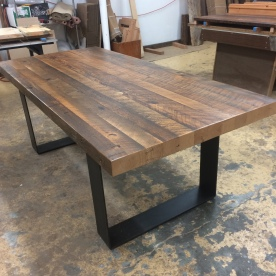 Doug fir dining table with steel base by Industrial Strength Design