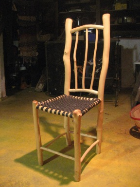 chair made from salvaged maple sticks from road clearing at Park Hill Orchard, Mass. Seat caning made from bicycle inner tubes.