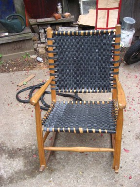 Rustic rocker restored with bicycle inner tube caning.